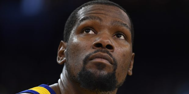 Golden State Warriors' Kevin Durant (35) glances up at the scoreboard while playing against the San Antonio Spurs during the fourth quarter of their NBA game at the Oracle Arena in Oakland, Calif., on Thursday, March 8, 2018. The Golden State Warriors defeated the San Antonio Spurs 110-107. (Jose Carlos Fajardo/Bay Area News Group)