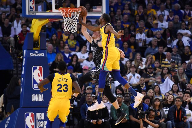 Golden State Warriors' Kevin Durant (35) blocks a shot by San Antonio Spurs' Davis Bertans (42) during the first quarter of their NBA game at the Oracle Arena in Oakland, Calif., on Thursday, March 8, 2018.