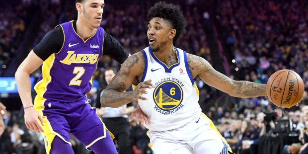 Golden State Warriors' Nick Young (6) gets past Los Angeles Lakers' Lonzo Ball (2) in the first period of their NBA game at Oracle Arena in Oakland, Calif., on Wednesday, March 14, 2018. (Doug Duran/Bay Area News Group)