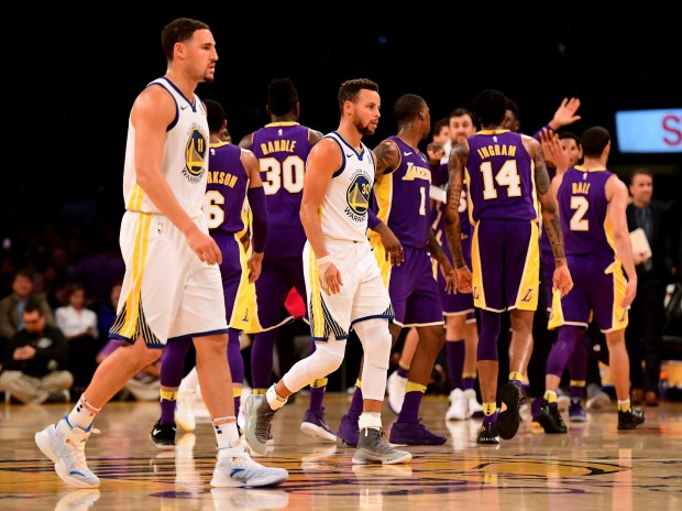 LOS ANGELES, CA NOVEMBER 29: Stephen Curry #30 and Klay Thompson #11 of the Golden State Warriors leaves the court as the Los Angeles Lakers celebrate a basket to trail 48-47 during the first half at Staples Center on November 29, 2017 in Los Angeles, California. (Photo by Harry How/Getty Images)