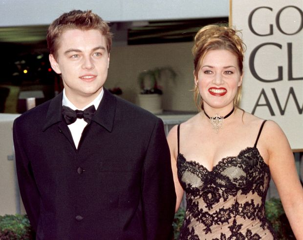 "BEVERLY HILLS, CA - JANUARY 18: Actor Leonardo DiCaprio (L) arrives with actress and Titanic co-star Kate Winslet for the 55th Annual Golden Globe Awards at the Beverly Hilton 18 January 1998 in Beverly Hills, CA. DiCaprio is nominated for Best Actor in the drama category for his role in ""Titanic"". ""Titanic"" is also nominated for Best Picture, Best Director and Best Actress in the same category. (Photo credit should read HAL GARB/AFP/Getty Images)"