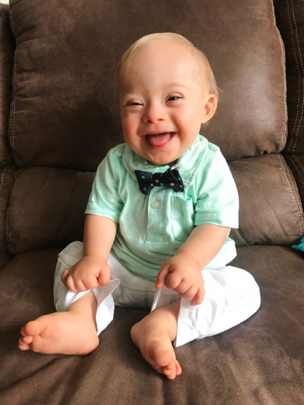 """This September 2017 undated photo provided by the Warren family via Gerber shows 14-month-old Lucas Warren of Dalton, Ga. Lucas' contagious smile won over executives at Gerber baby food who have made him their """"spokesbaby"""" this year. Lucas is Gerber's first spokesbaby with Down syndrome in the company's 91-year history. (Courtesy Warren family/Gerber via AP)"""