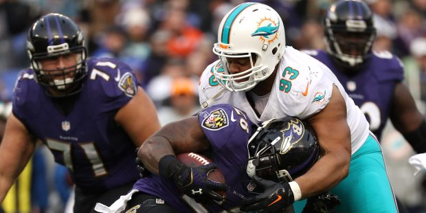 BALTIMORE, MD - DECEMBER 4: Running back Terrance West #28 of the Baltimore Ravens carries the ball against defensive tackle Ndamukong Suh #93 of the Miami Dolphins in the third quarter at M&T Bank Stadium on December 4, 2016 in Baltimore, Maryland. (Photo by Patrick Smith/Getty Images)