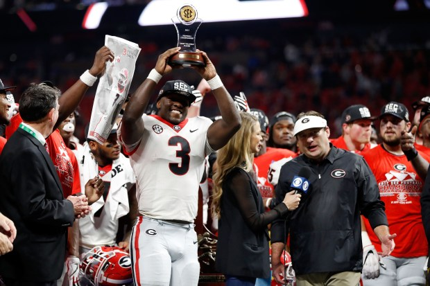 Roquan Smith #3 of the Georgia Bulldogs reacts to winning the game MVP trophy after beating the Auburn Tigers in the SEC Championship at Mercedes-Benz Stadium on December 2, 2017 in Atlanta, Georgia. (Photo by Jamie Squire/Getty Images)