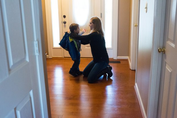 """Mandy Collens, 33, puts a coat on her son, James Collens, 3, before a walk.She attended her first meeting for Moms Demand Action 19 years after she ran from her high school in what was considered a """"copycat"""" shooting after Columbine. MUST CREDIT: Washington Post photo by Sarah L. Voisin"""
