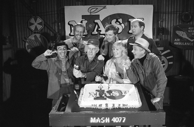 """1981: """"M*A*S*H"""" television series cast members. Front row: Jamie Farr, Harry Morgan, Loretta Swit, William Christopher . Back row: Mike Farrell, Alan Alda and David Ogden Stiers. (AP Photo/Huynh, File)"""