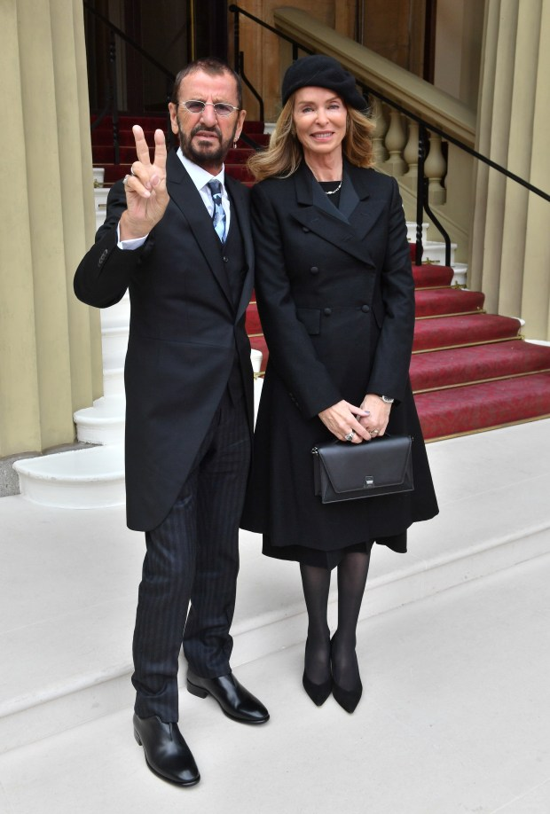 LONDON, ENGLAND - MARCH 20: Ringo Starr, real name Richard Starkey, poses with his wife Barbara Bach as he arrives at Buckingham Palace to receive his Knighthood at an Investiture ceremony on March 20, 2018 in London, England. (Photo by John Stillwell - WPA Pool/Getty Images)