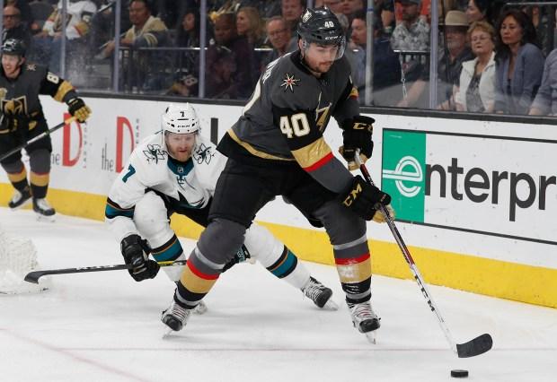 Vegas Golden Knights center Ryan Carpenter (40) skates around San Jose Sharks defenseman Paul Martin (7) during the first period of an NHL hockey game, Saturday, March 31, 2018, in Las Vegas. (AP Photo/John Locher)