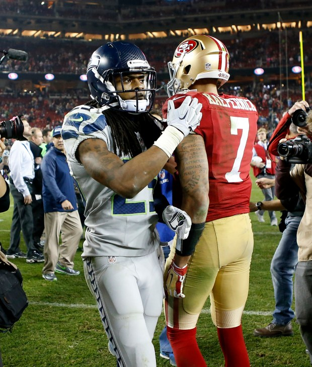 San Francisco 49ers' quarterback Colin Kaepernick (7) is tapped on the back by the Seattle Seahawks' Richard Sherman (25) as they leave the field after a 19-3 Seattle win at Levi's Stadium in Santa Clara, Calif., on Thursday, Nov. 27, 2014. (Josie Lepe/Bay Area News Group)