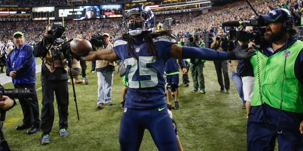 Cornerback Richard Sherman #25 of the Seattle Seahawks celebrates after making an interception in the second half against the San Francisco 49ers at CenturyLink Field on September 15, 2013 in Seattle, Washington. The Seahawks defeated the 49ers 29-3. (Otto Greule Jr/Getty Images)