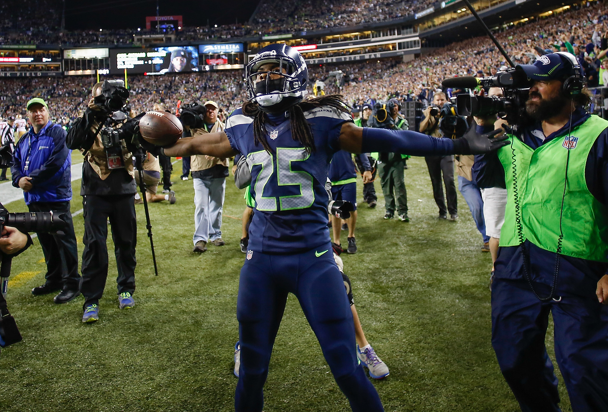 Cornerback Richard Sherman #25 of the Seattle Seahawks celebrates after making an interception in the second half against the San Francisco 49ers at Century Link Field