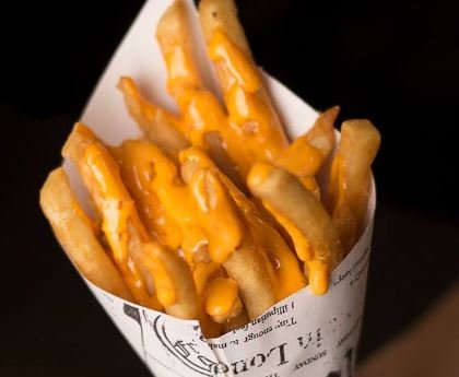 The French fries at #GetFried come by the cone, with your choice ofdipping sauce, or in baskets with meat-and-cheese toppings. (Photo courtesy of #GetFried)