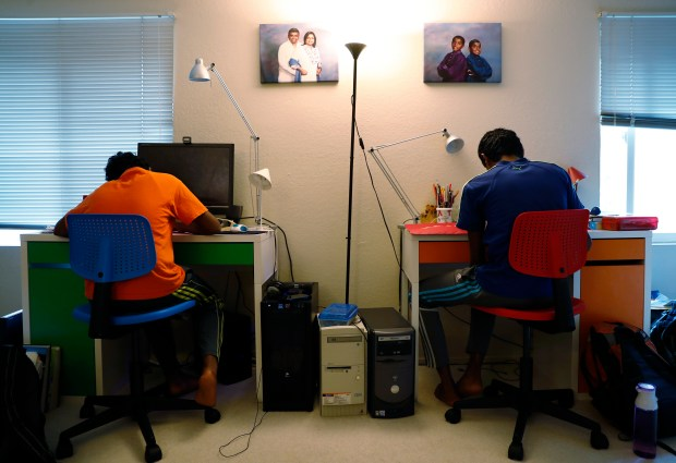 Vishruth Iyer, left, 15, and his twin brother Pratyush, do homework in their study room of their home in Cupertino, Calif., on Wednesday, March 28, 2018. (Nhat V. Meyer/Bay Area News Group)