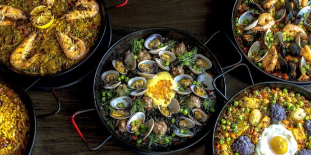 La Marcha, a Spanish tapas bar in Berkeley, is hosting Paella Feast, acommunity-style dinner on April 6 where guests can taste five kinds of paella for $30. (Photo courtesy of La Marcha)