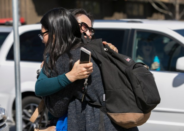 Palo Alto High School junior Renle Chu, 16, hugs her mother Witty Wang after Palo Alto High School's lockdown was lifted in Palo Alto, on Thursday, March 29, 2017. Chu said the school went into lockdown after a phone threat, and that her classmates had started to barricade her classroom unit the lockdown was lifted, when the threat was deemed a hoax. (LiPo Ching/Bay Area News Group)