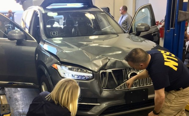National Transportation Safety Board investigators examine the Uberself-driving vehicle that struck and killed a pedestrian in Arizona on March 19, 2018. (National Transportation Safety Board)