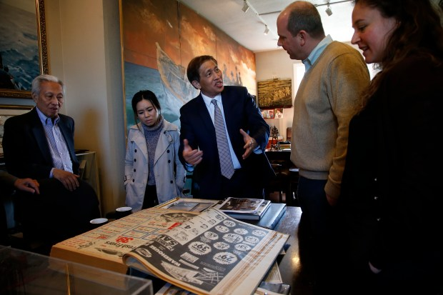 Nam Pham, center, talks with visitors to the Viet Museum, Monday, March 26, 2018, in San Jose, Calif. Pham is a leading advocate in the local Vietnamese community raising funds to place a Lone Sailor Statue in Guam this spring. (Karl Mondon/Bay Area News Group)