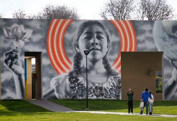 """The El Mac mural, """"Sophie Holding the World Together"""" is photographed in San Jose, Calif. (Karl Mondon/Bay Area News Group)"""