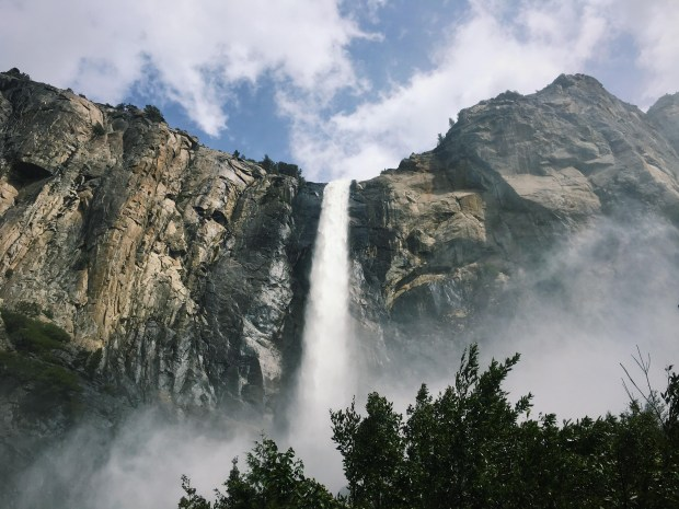 The spring April 2017 view of Bridalveil Fall roaring over the south rim of Yosemite Valley. Yosemite officials are putting the final touches on a $13 million restoration plan of the area, with half the funding coming from a Bay Area non-profit group, the Yosemite Conservancy. The new plan will feature a larger parking lot, modern flush toilets, interpretive signs and wider hiking trails with wooden boardwalks and more accessible features designed in the classic granite and pine national park style. The project will begin in the spring of 2019 and be completed a year later. (Couresty Alexa Ward/Yosemite Conservancy)