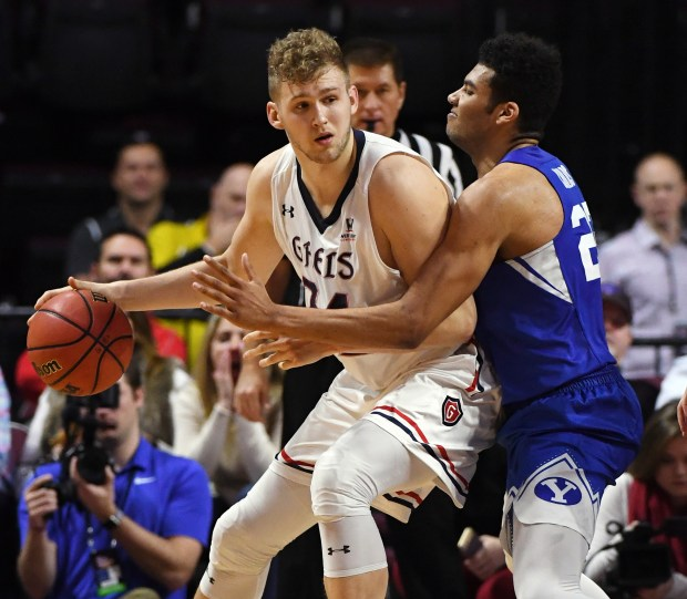 LAS VEGAS, NV - MARCH 05: Jock Landale #34 of the Saint Mary's Gaels is guarded by Yoeli Childs #23 of the Brigham Young Cougars during a semifinal game of the West Coast Conference basketball tournament at the Orleans Arena on March 5, 2018 in Las Vegas, Nevada. The Cougars won 85-72. (Photo by Ethan Miller/Getty Images)