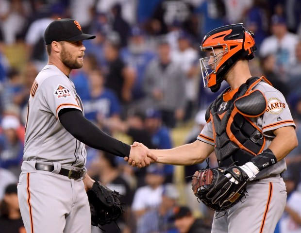 LOS ANGELES, CA - MARCH 29:  Hunter Strickland #60 of the San Francisco Giants celebrates a 1-0 win over the Los Angeles Dodgers with Buster Posey #28 during the 2018 Major League Baseball opening day at Dodger Stadium on March 29, 2018 in Los Angeles, California.  (Photo by Harry How/Getty Images)