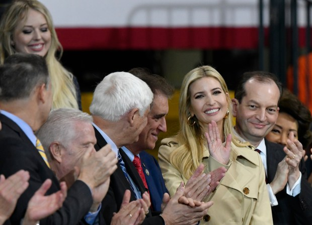 Ivanka Trump, second from right, the daughter and assistant to President Donald Trump, listens to her father speak at Local 18 Richfield Training Facility, Thursday, March 29, 2018, in Richfield, Ohio. Also at the event is Trump's daughter Tiffany Trump, upper left. (AP Photo/David Richard)