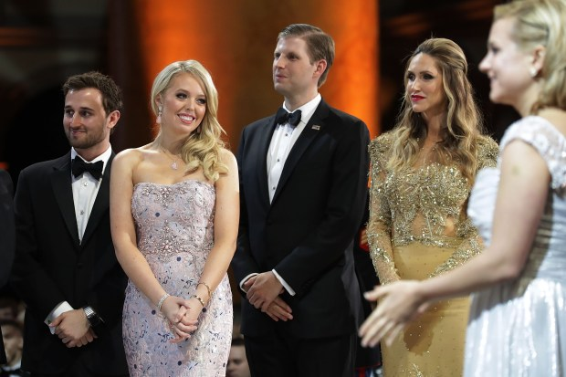WASHINGTON, DC - JANUARY 20: (L-R) Tiffany Trump (2nd L) and her guest Ross Mechanic (L), and Eric Trump and his wife Lara Yunaska watch as U.S. President Donald Trump cuts a cake during the inaugural Armed Services Ball at the National Building Museum January 20, 2017 in Washington, DC. The ball is part of the celebrations following the inauguration of Trump. (Photo by Chip Somodevilla/Getty Images)