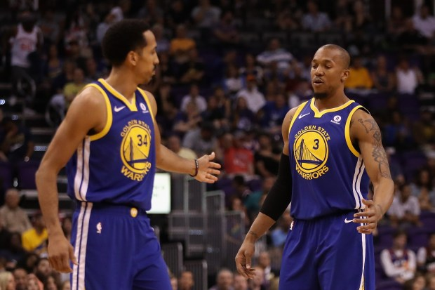 PHOENIX, AZ - APRIL 08: David West #3 of the Golden State Warriors high fives Shaun Livingston #34 during the first half of the NBA game against the Phoenix Suns at Talking Stick Resort Arena on April 8, 2018 in Phoenix, Arizona. NOTE TO USER: User expressly acknowledges and agrees that, by downloading and or using this photograph, User is consenting to the terms and conditions of the Getty Images License Agreement. (Photo by Christian Petersen/Getty Images)