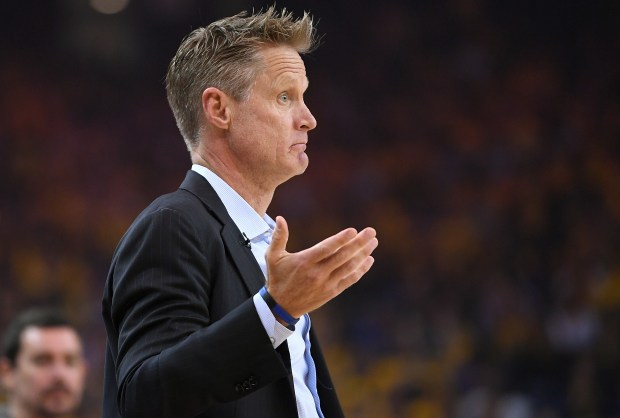 OAKLAND, CA - APRIL 14: Head coach Steve Kerr of the Golden State Warriors looks on and reacts to the play on the court against the San Antonio Spurs in the first quarter during Game One of the first round of the 2018 NBA Playoff at ORACLE Arena on April 14, 2018 in Oakland, California. NOTE TO USER: User expressly acknowledges and agrees that, by downloading and or using this photograph, User is consenting to the terms and conditions of the Getty Images License Agreement. (Photo by Thearon W. Henderson/Getty Images)