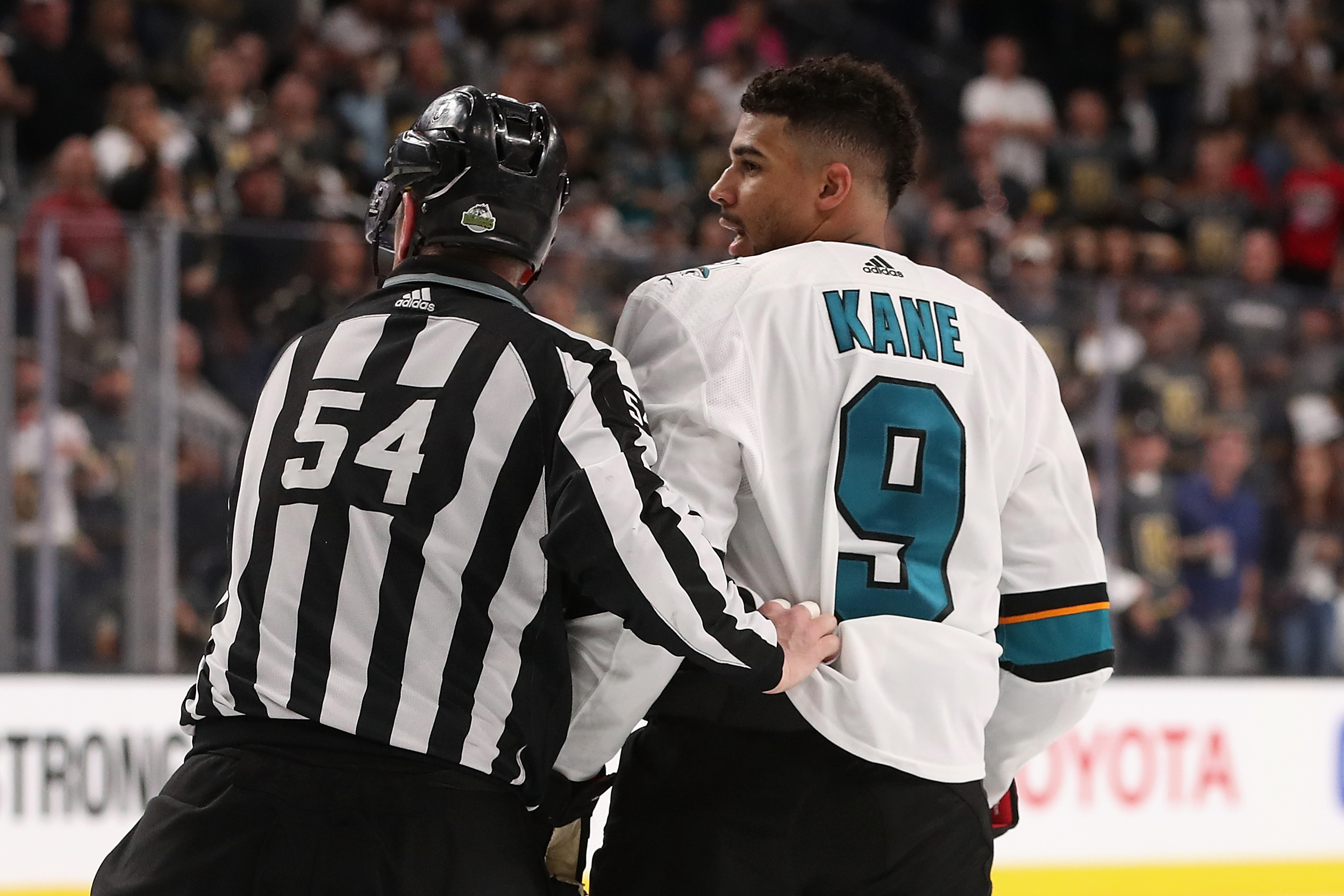 GLENDALE NV- APRIL 26 Evander Kane #9 of the San Jose Sharks is escorted off the ice by linesman Greg Devorski #54 after a 5 minute major penalty and game misconduct in the third period Game One of the Western Conference Second Round against the Vegas