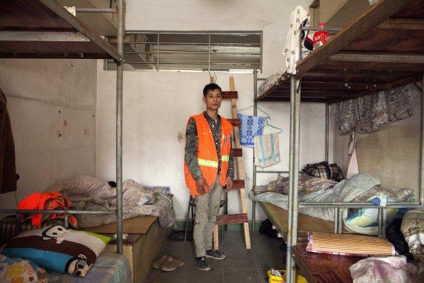 Li Weibin, 30, construction worker from Hunan, lives in a dormitory inChang'an. He came to Guangzhou when he was 13 years old. MUST CREDIT: Photo for The Washington Post by Giulia Marchi