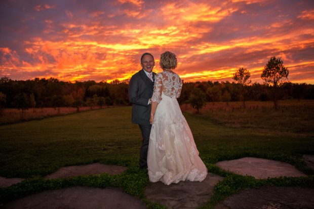 J McKnight, left, and wife Rhonda Morton pose for a sunset photo at their wedding in Upstate New York. (Photo Josh Baldo)