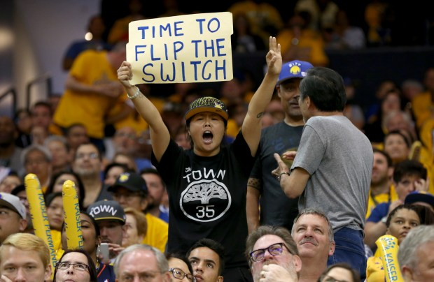 A Golden State Warriors fan holds up a sign in the third quarter of Game 1 of their NBA first-round playoff series against the San Antonio Spurs at Oracle Arena in Oakland, Calif., on Saturday, April 14, 2018. (Anda Chu/Bay Area News Group)