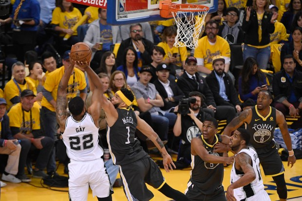 San Antonio Spurs' Rudy Gay (22), left, tries to shoot over Golden State Warriors' JaVale McGee (1) during the first quarter of Game 2 of their NBA first-round playoff series at Oracle Arena in Oakland, Calif., on Monday, April 16, 2018. (Jose Carlos Fajardo/ Bay Area News Group)