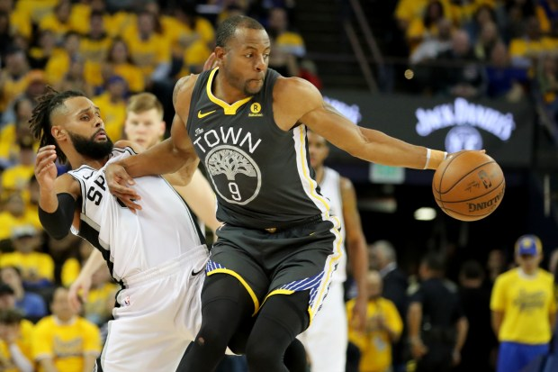 Golden State Warriors' Andre Iguodala (9) dribbles against San Antonio Spurs' Patty Mills (8) during the second quarter of Game 2 of their NBA first-round playoff series at Oracle Arena in Oakland, Calif., on Monday, April 16, 2018.(Ray Chavez/Bay Area News Group)