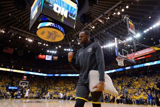 Golden State Warriors' Andre Iguodala (9) pumps his fist after a basket by a teammate during the fourth quarter of Game 2 of their NBA first-round playoff series at Oracle Arena in Oakland, Calif., on Monday, April 16, 2018. The Golden State Warriors defeated the San Antonio Spurs 116-101. (Jose Carlos Fajardo/Bay Area News Group)