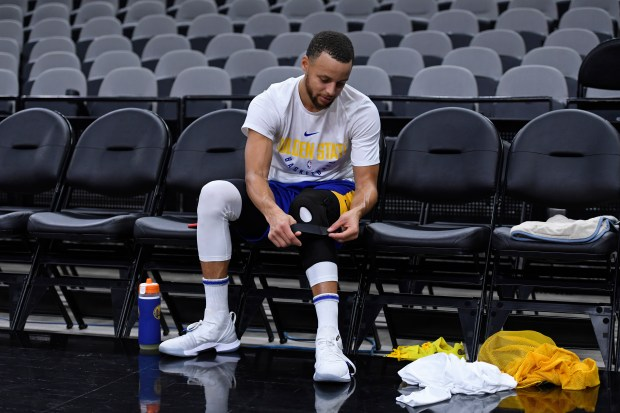 Golden State Warriors' Stephen Curry (30) removes his knee brace during a practice session at AT&T Center in San Antonio, Texas, on Saturday, April 21, 2018. The Golden State Warriors will face the San Antonio Spurs tomorrow for Game 4 of their NBA playoff series. The Warriors lead the series 3-0. (Jose Carlos Fajardo/Bay Area News Group)
