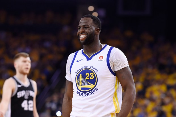 Golden State Warriors' Draymond Green (23) smiles after a call against the Warriors during the second quarter of Game 5 of their NBA first-round playoff series at Oracle Arena in Oakland, Calif., on Tuesday, April 24, 2018. (Jose Carlos Fajardo/ Bay Area News Group)