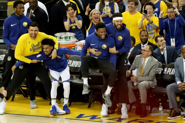 The Golden State Warriors bench and fans celebrate Klay Thompson 3-point basket against the New Orleans Pelicans during the second quarter of Game 1 of the NBA Western Conference semifinals at Oracle Arena in Oakland, Calif., on Saturday, April 28, 2018. (Ray Chavez/Bay Area News Group)
