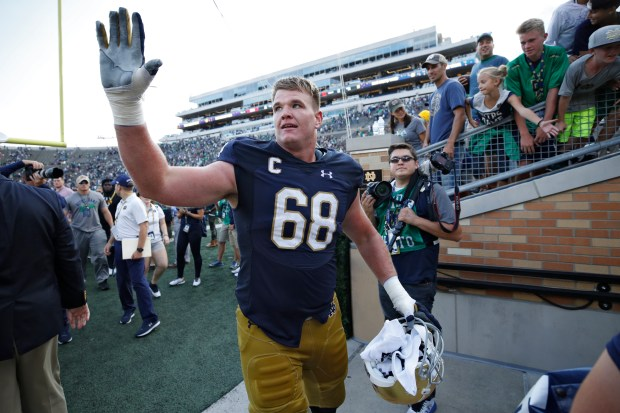 Mike McGlinchey #68 of the Notre Dame Fighting Irish celebrates as he leaves the field following a game against the Temple Owls at Notre Dame Stadium on September 2, 2017 in South Bend, Indiana. The Irish won 49-16. (Photo by Joe Robbins/Getty Images)