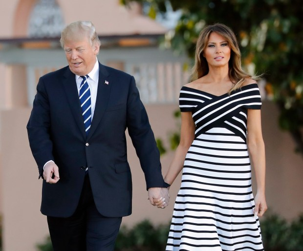 President Donald Trump, first lady Melania Trump, walks with Japanese Prime Minister Shinzo Abe and his wife Akie Abe as they walk to dinner at Trump's private Mar-a-Lago club, Tuesday, April 17, 2018, in Palm Beach, Fla. (AP Photo/Pablo Martinez Monsivais)