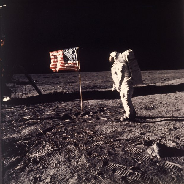 "FILE - In this July 20, 1969 file photo, Astronaut Edwin E. ""Buzz"" Aldrin Jr. poses for a photograph beside the U.S. flag deployed on the moon during the Apollo 11 mission. (AP Photo/Neil Armstrong, NASA, file)"