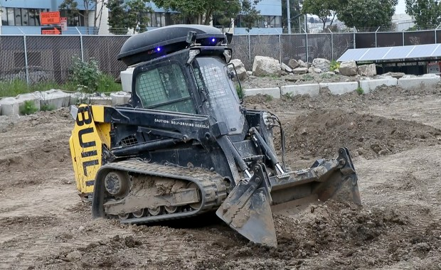 "Built Robotics self-driving compact track loader, playfully named ""Mary Anne"", works in a demonstration yard behind the company's offices in San Francisco, Calif., Thursday, April 5, 2018. (Karl Mondon/Bay Area News Group)"