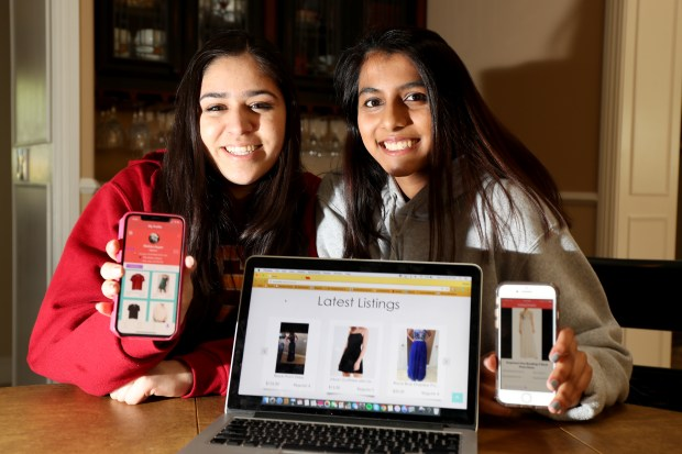 Riya Gupta, 16, left, and Nishka Ayyar, 17, of Saratoga, show off the website and app they built at Ayyar's home in Saratoga, Calif., on Wednesday, April 18, 2018. The students, both juniors at The Harker School in San Jose, Calif., built the PromElle app to allow teens to rent and lend prom and formal dresses. (Ray Chavez/Bay Area News Group)