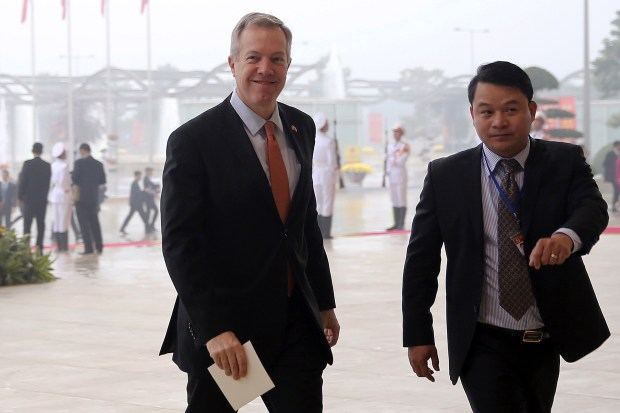 U.S. Ambassador to Vietnam Ted Osius, left, arrives for the opening ceremony of the Communist Party of Vietnam's 12th Congress in Hanoi, Vietnam Thursday, Jan. 21, 2016. Vietnam's ruling Communist Party on Thursday opened the eight-day congress that will culminate with the naming of a set of leaders who will govern the country for the next five years. (Luong Thai Linh/Pool Photo via AP)
