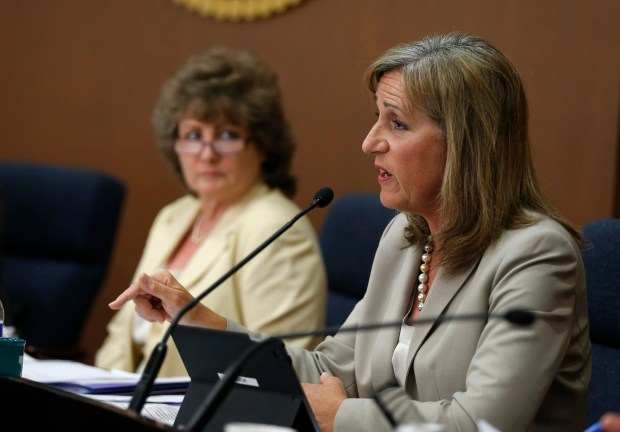 Lisa Gillmor, left,  and Debi Davis during a city council meeting in Santa Clara, Calif., on Tuesday, April 21, 2015. (Patrick Tehan/Bay Area News Group)