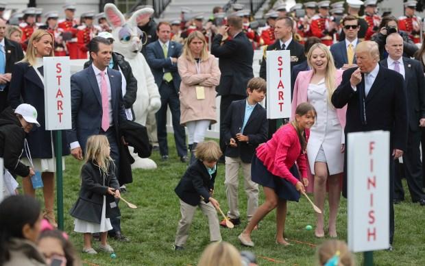 Four of Trump's grandchildren -- Chloe, Spencer, Donald and Kai. Looking on are, from left, Vanessa Trump, Donald Trump Jr., and Tiffany Trump. (AP Photo/Pablo Martinez Monsivais)