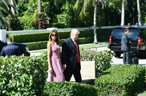 US President Donald Trump(R)and First Lady Melania Trump (L) arrive for Easter service at the Church of Bethesda-by-the-Sea in Palm Beach, Florida, April 1, 2018. / AFP PHOTO / Nicholas Kamm (Photo credit should read NICHOLAS KAMM/AFP/Getty Images)