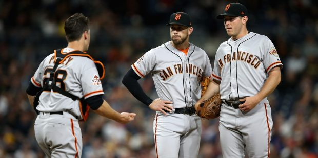SAN DIEGO, CA - APRIL 13: Buster Posey #28, Curt Young #43 of the San Francisco Giants and Ty Blach #50 of the San Francisco Giants talk on the mound during the fifth inning of a game against the San Diego Padres at PETCO Park on April 13, 2018 in San Diego, California. (Photo by Sean M. Haffey/Getty Images)