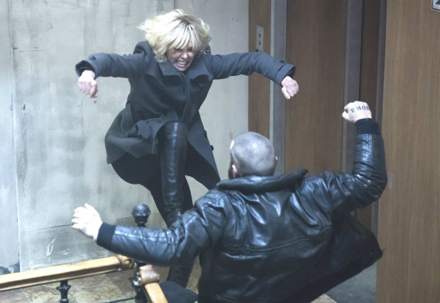 "Charlize Theron, at rear, in a much-discussed fight scene from ""AtomicBlonde."" (Jonathan Prime/Focus Features)"